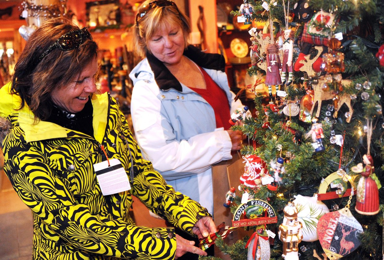Barb Prater, left, and Susan Mann, skiers in town from Pratt, Kan., check out Christmas ornaments at Steamboat Art Co. in downtown Steamboat Springs on Sunday afternoon. The day's slower pace brought a respite for local shop owners after busy Black Friday weekend had them hopping. Steamboat Art Co. owner Melinda Miller said business was up significantly from the same weekend last year.