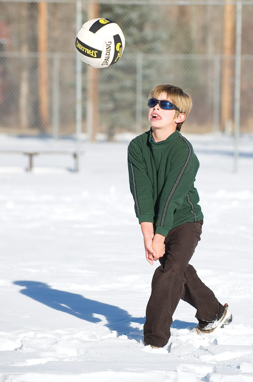 Steamboat Springs' Lucas Sands passes the ball back to his father, Barry, on Tuesday while playing volleyball at Howelsen Hill. Steamboat Springs has been treated to several days of mild weather, leaving many locals to wonder where the snow has gone.