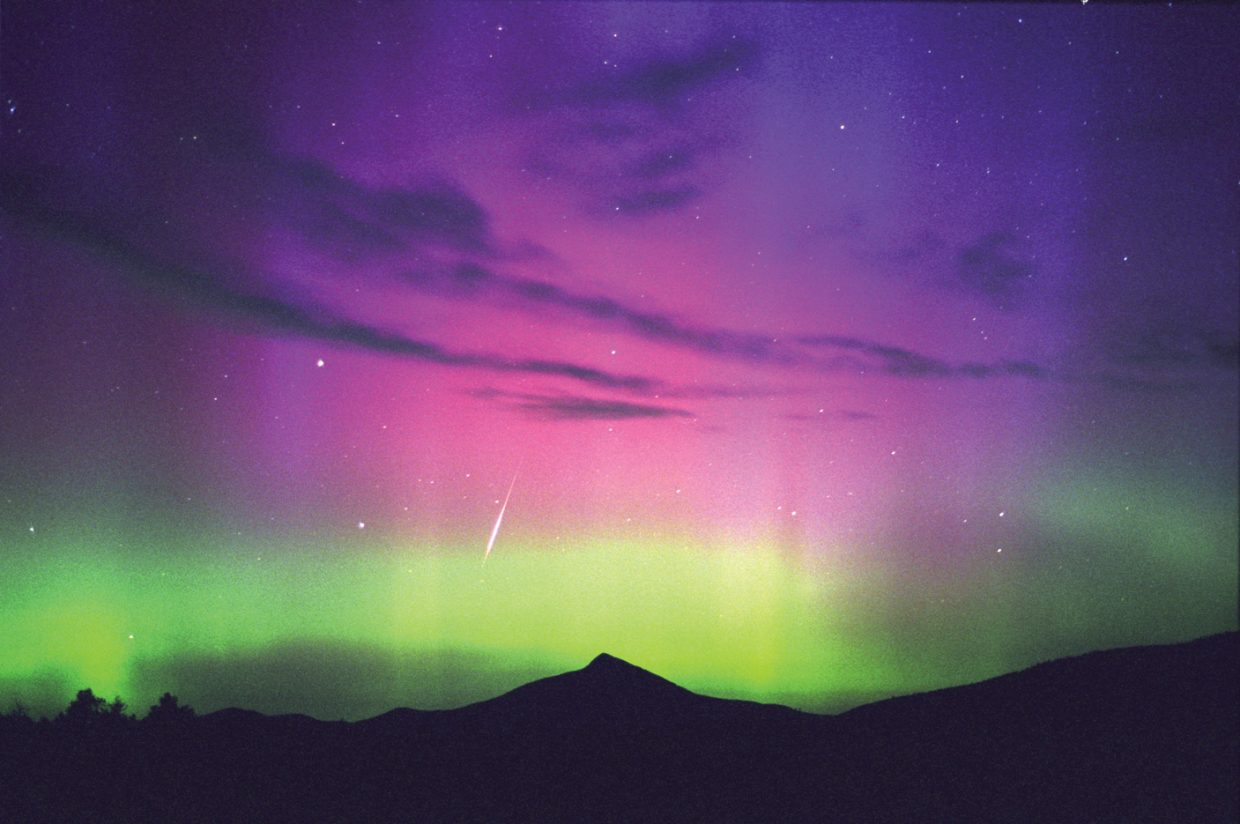 This display of the Northern Lights broke out over Colorado during the last solar maximum in August 2000. The colorful lights and a bright meteor were captured over Hahn's Peak in this 30-second time exposure. As the next solar maximum approaches, our chances for seeing more auroras like this improve.