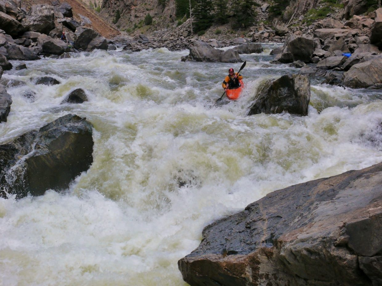 Sam Smiley at Tunnel Falls. The group of eleven paddled the four miles of flatwater from Kremmling to enter the Gore Canyon for five miles of whitewater. Submitted by: Matt Helm