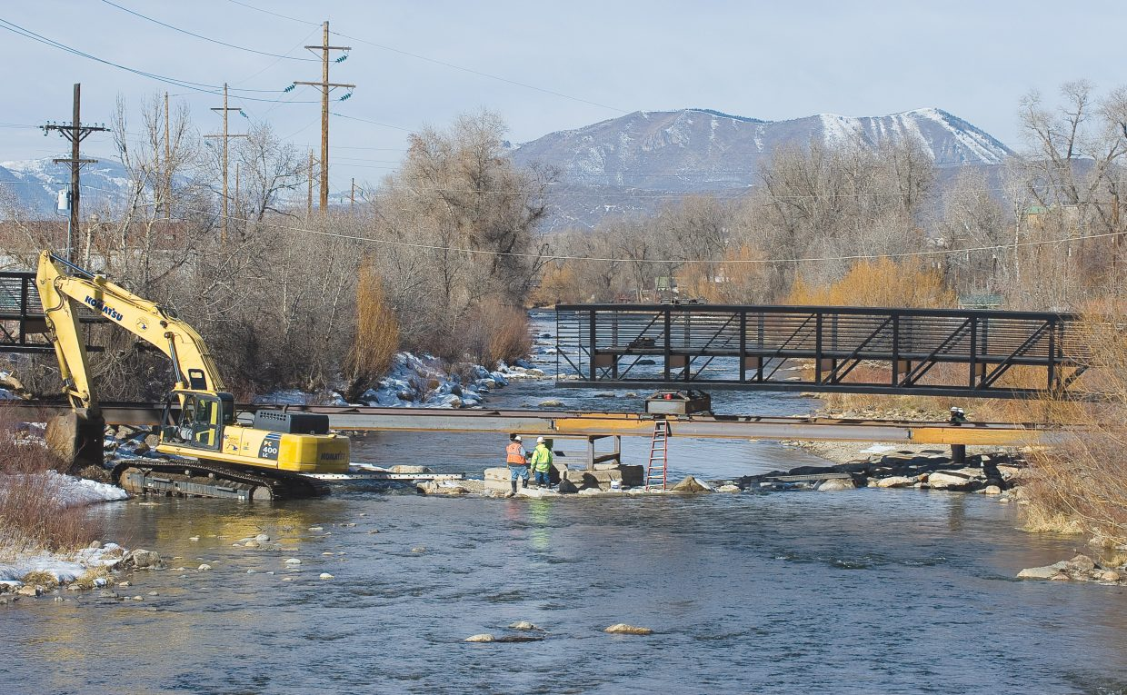 Crews install a pedestrian footbridge Wednesday that will connect the Yampa River Core Trail in front of the Depot Art Center to West Lincoln Park.