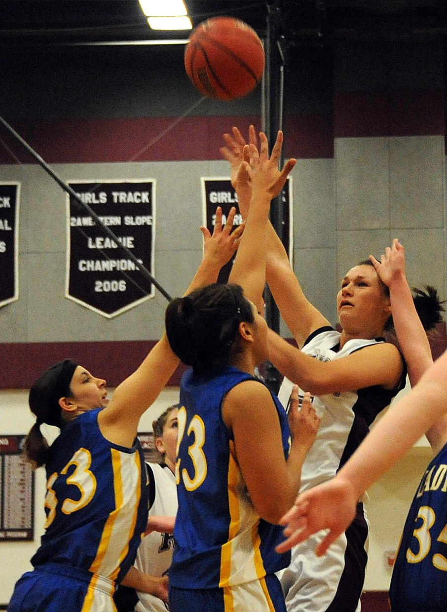 Soroco's Madison George puts up a shot in traffic Thursday.