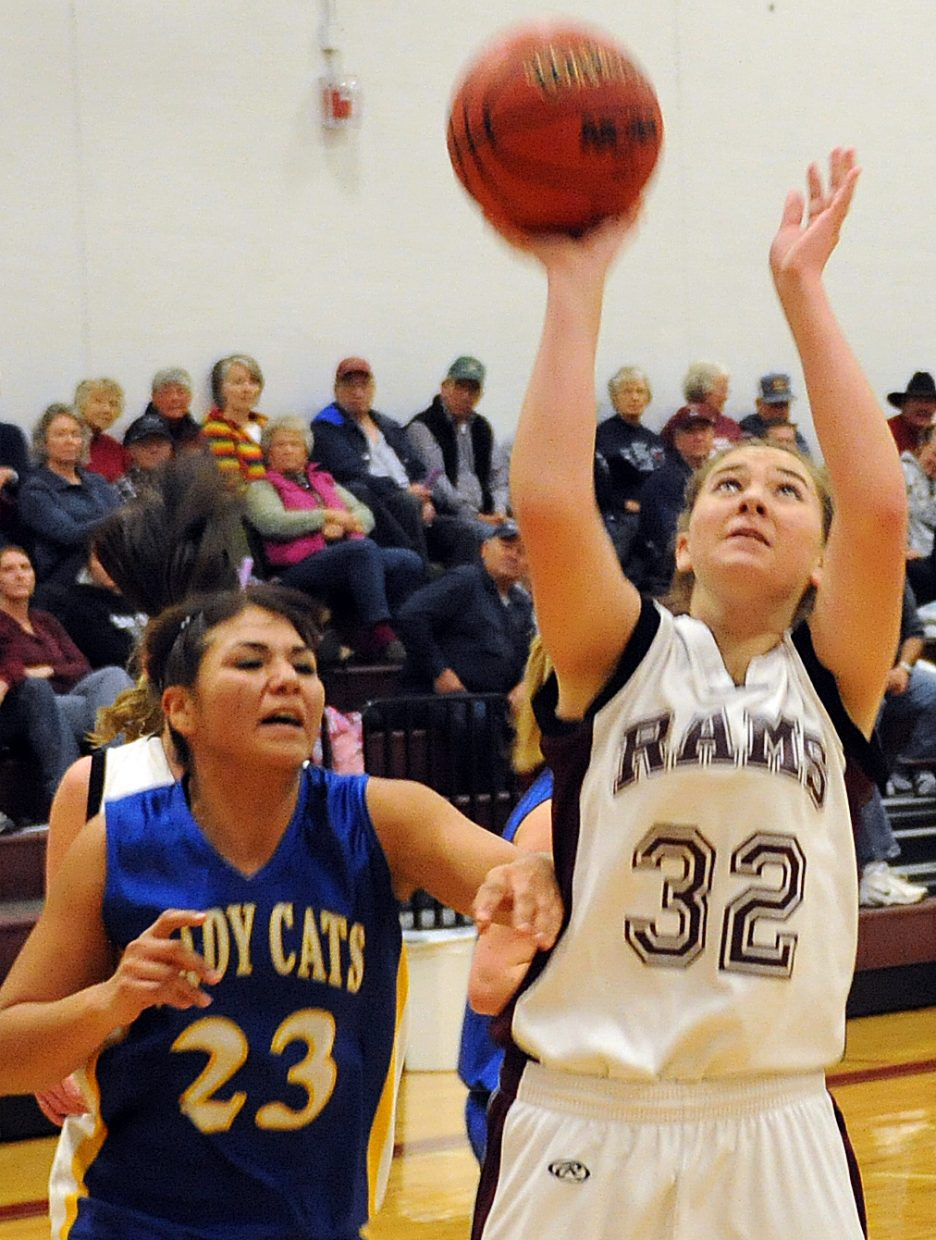 Jacey Schlegel puts up a shot after grabbing an offensive rebound Thursday in a win against North Park.