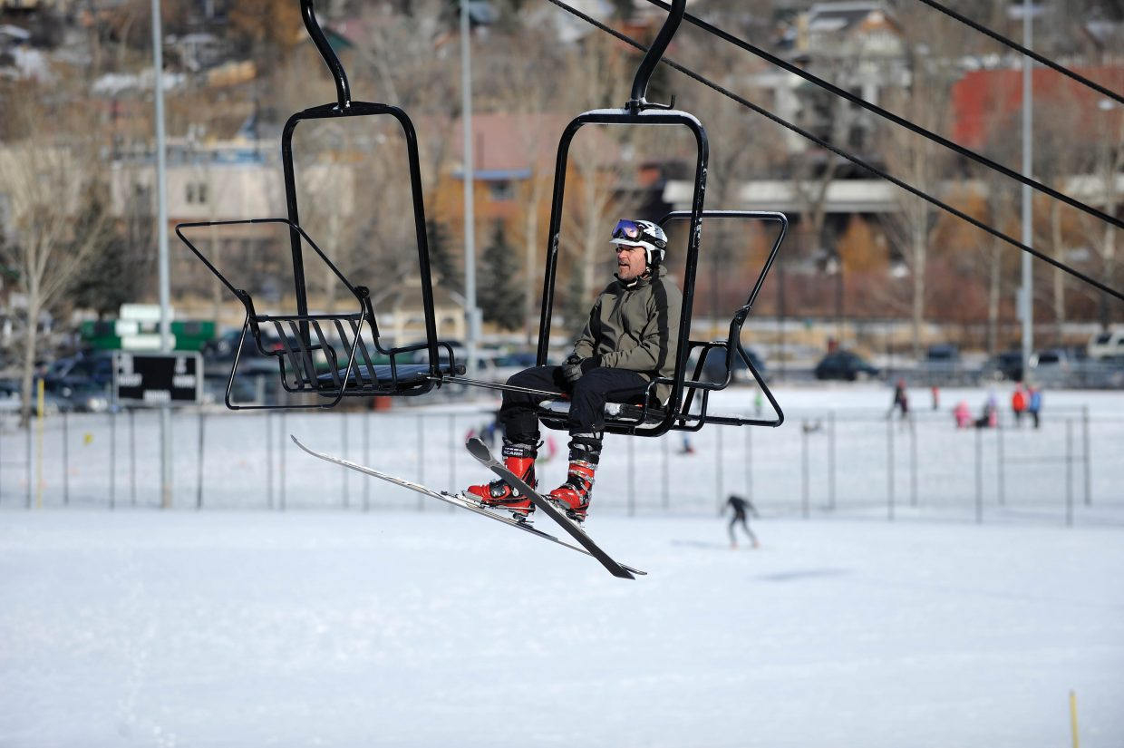 Steamboat Springs resident Ryan Overstake rides up the first chair Saturday morning at Howelsen Hill.