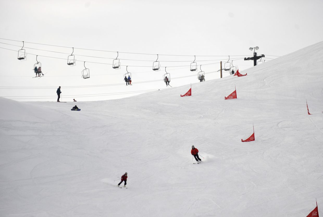 Skiers come down Howelsen Hill on opening day in 2011.