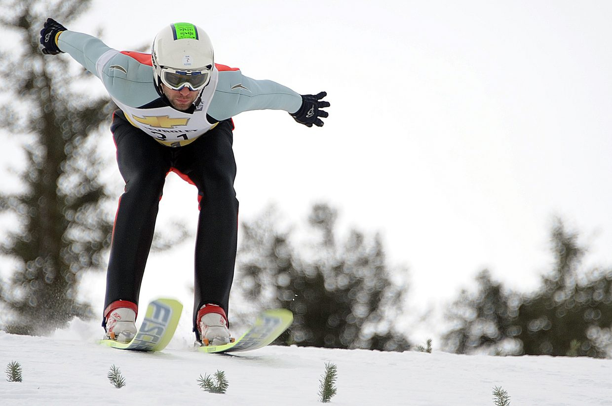 Czech Republic jumper Robert Kartik's skis slap down on the snow Saturday as he lands a jump during the Nordic combined competition at Howelsen Hill. The event attracted about three dozen jumpers from the United States, Canada and the Czech Republic.