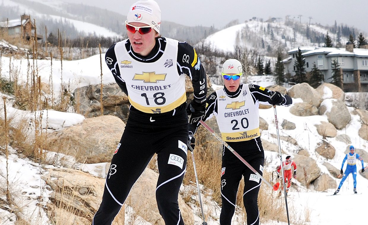Tyler Smith and Adam Loomis ski down the trail during the cross-country portion of Saturday's Nordic combined race in Steamboat Springs.
