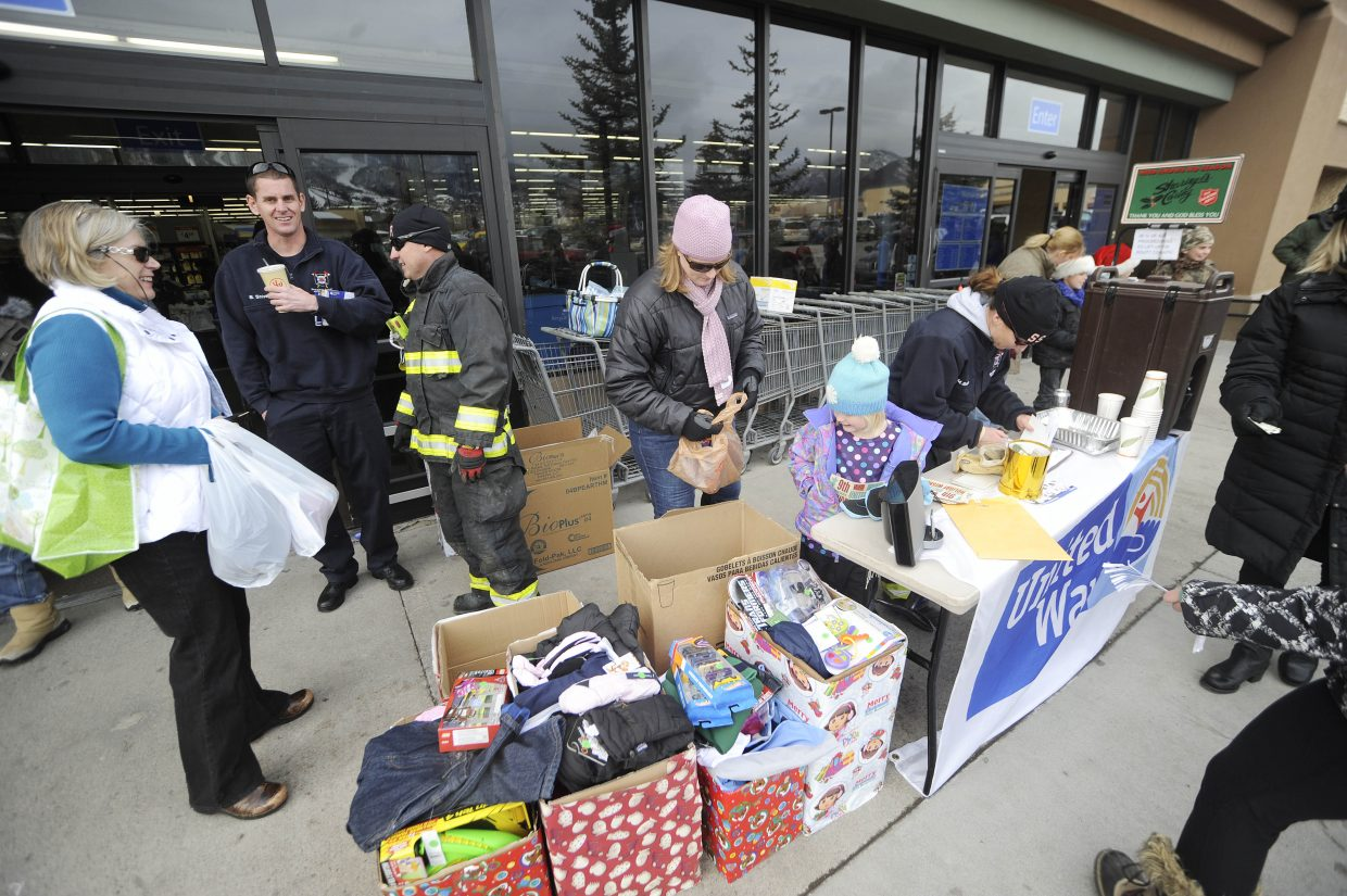 """Steamboat Springs Fire Rescue firefighters and volunteers collect gifts Saturday in front of Walmart for the ninth annual Holiday Wishes campaign, which collects gifts for local needy families. Through Dec. 19, visit www.mygiftlist.com, click on the """"Find Gift Registry"""" tab and type First Name: """"Steamboat"""" and Last Name: """"Holiday Wishes"""" to view a gift list. Wrapped gifts will be collected during a holiday party from 4 to 8 p.m. Dec. 11 at Rex's American Grill & Bar."""