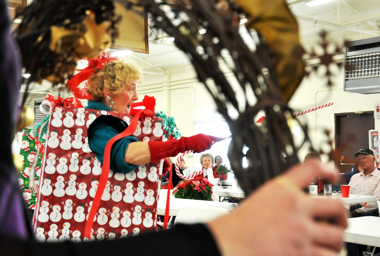 Linda Archuleta accepts bids for a wreath at the Hayden Christmas Tree Festival.