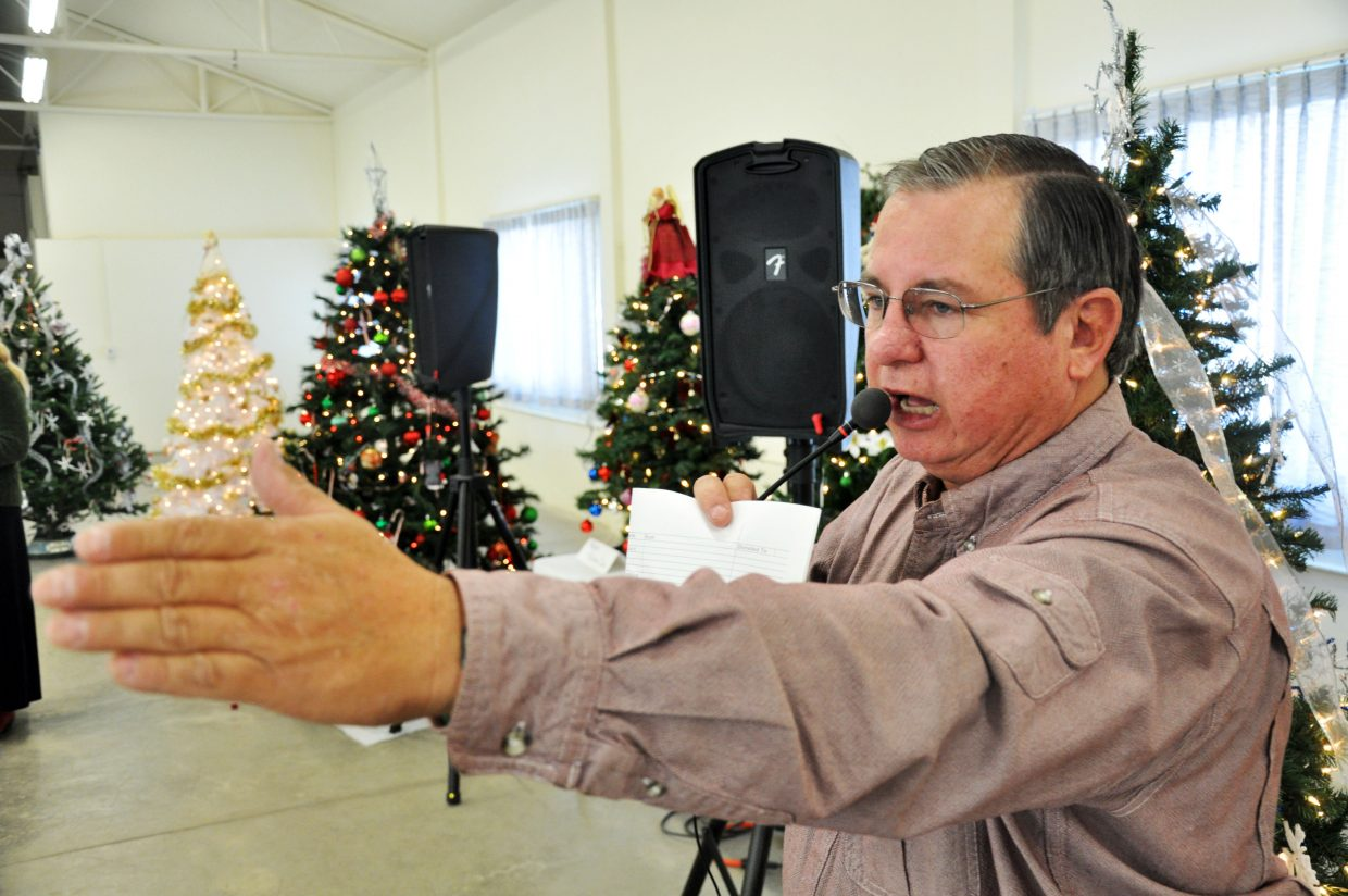 Kenny Kawcak calls an auction Sunday in Hayden during the Hayden Christmas Tree Festival.