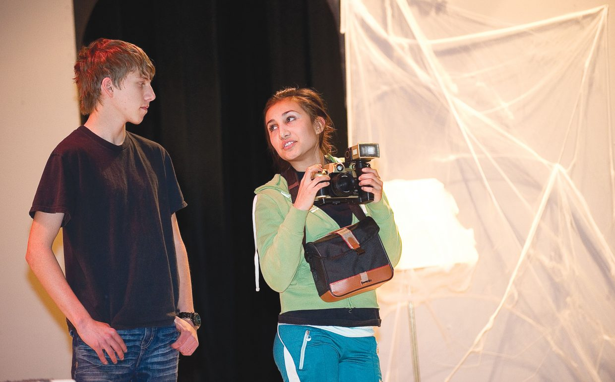 "Sofia Rodrigez, who plays the part of Madge, shares a scene with Brandon Dorr, who plays Tyler Thorncraft, during a rehearsal Wednesday for Hayden High School's production of ""Honeymoon at Graveside Manor."" Performances are 7 p.m. Friday and Saturday. There also will be a matinee at 1 p.m. Saturday."