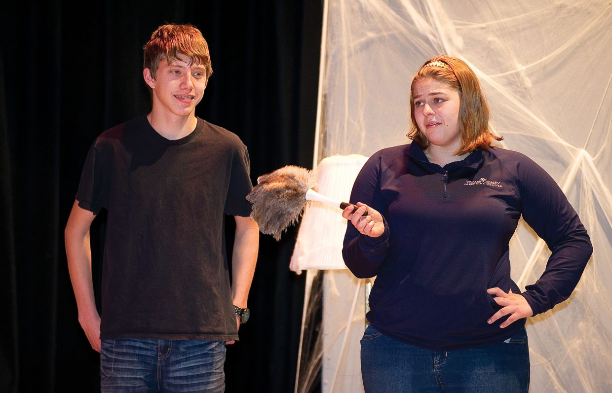 "Ashley Otto, who plays the part of cleaning lady Sophie, shares a scene with Brandon Dorr, who plays Tyler Thorncraft, during a rehearsal Wednesday for Hayden High School's production of ""Honeymoon at Graveside Manor."" Performances are 7 p.m. Friday and Saturday. There also will be a matinee at 1 p.m. Saturday."