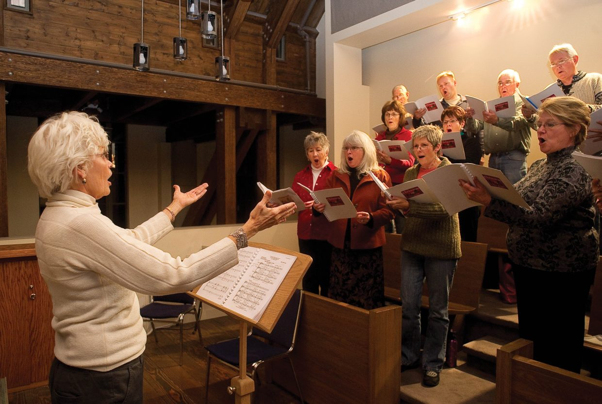 Director Marie Carmichael leads the Steamboat Chamber Singers at rehearsal Wednesday evening at the St. Paul's Episcopal Church.