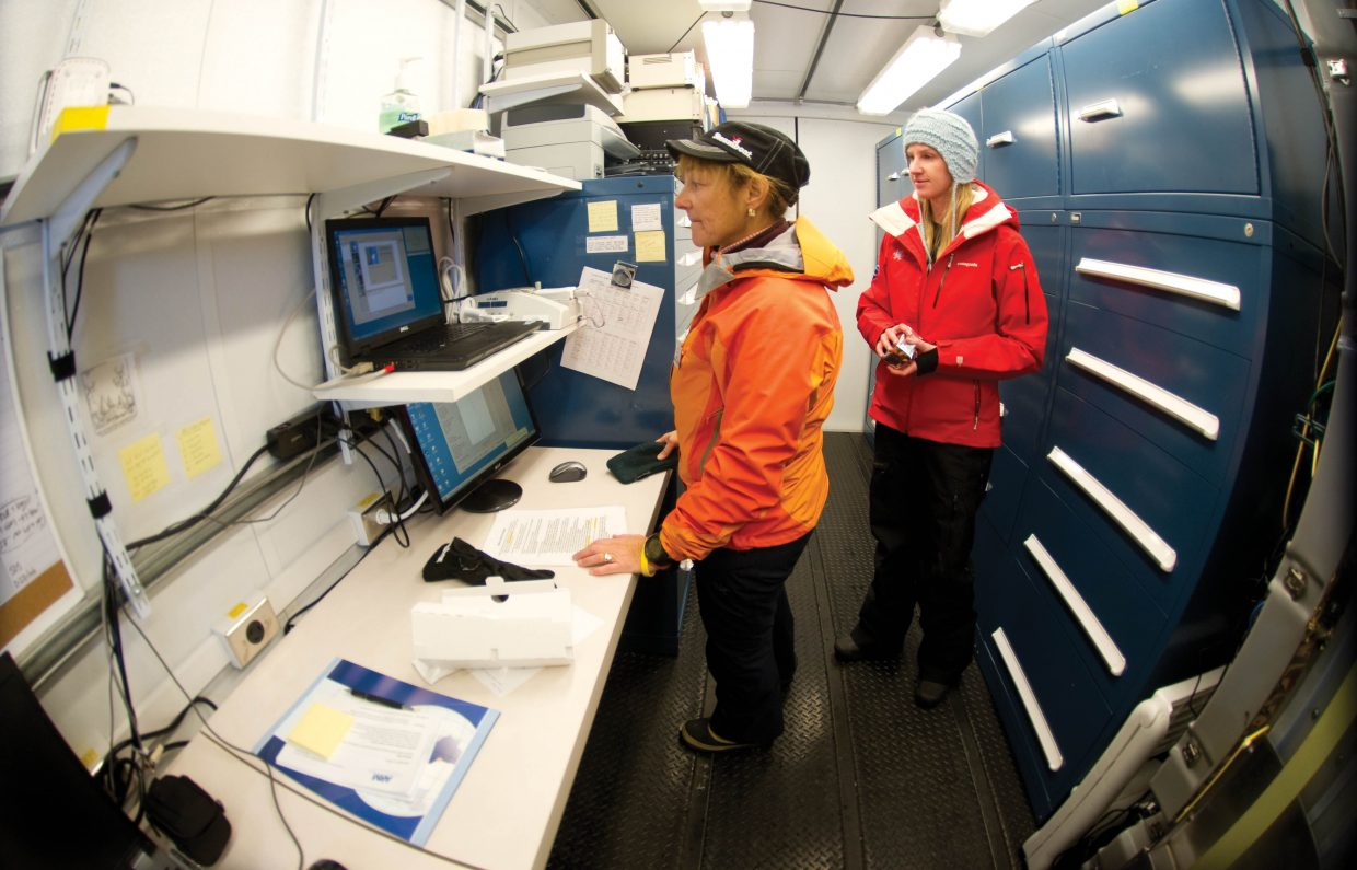 Linda Danter, a volunteer for the Storm Peak Laboratory Cloud Property Validation Experiment, and scientist Nicki Hickmon check to make sure equipment is working properly inside a small trailer located near Yampa Valley Medical Center in Steamboat Springs.