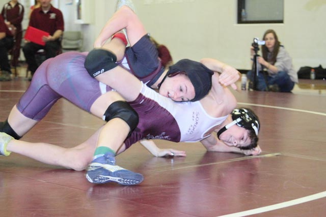 Soroco's Lauryn Bruggink wrestles against Paonia Independent's Jack Bair on Saturday at a tournament in Oak Creek.