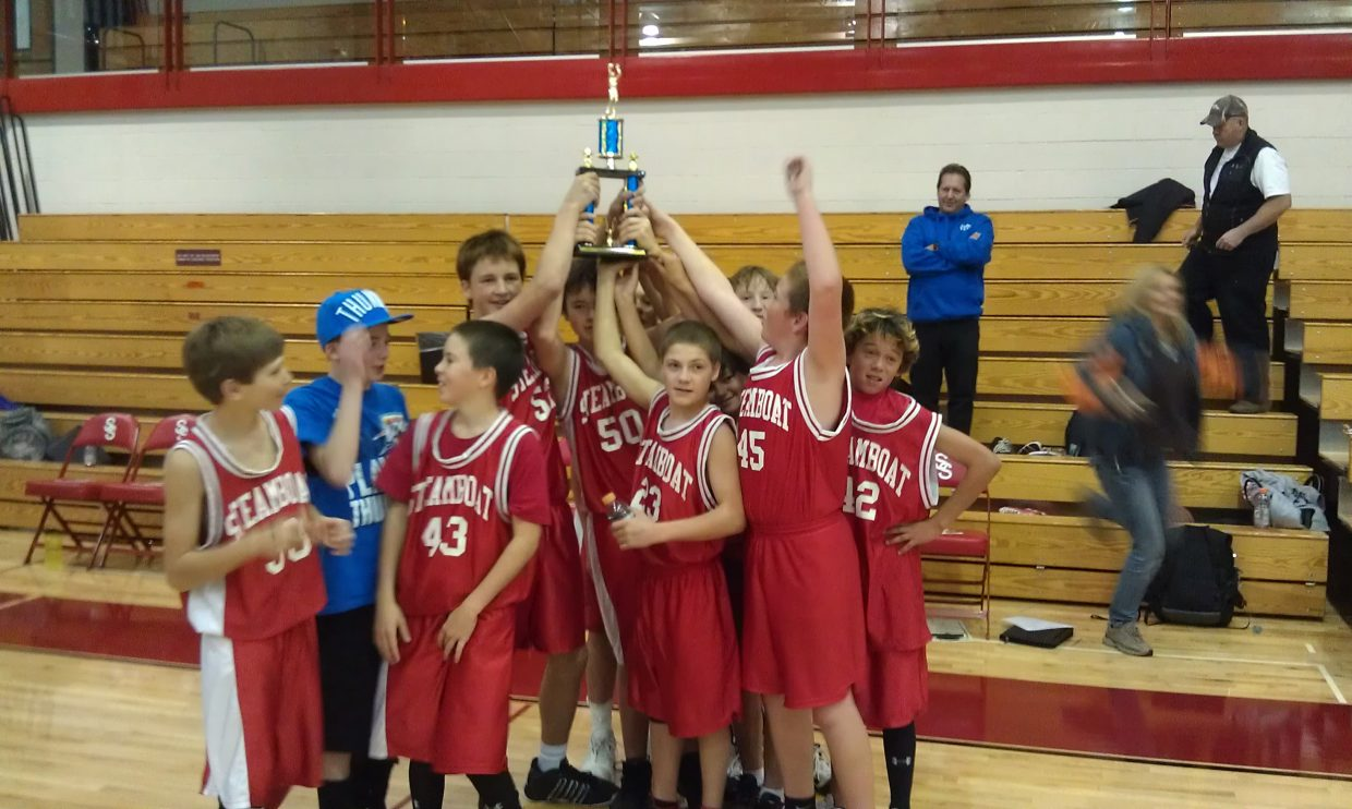 The Steamboat Springs seventh-grade basketball team celebrates after beating Moffat County in a year-end tournament. The team lost to Moffat twice in the regular season before winning the final game.