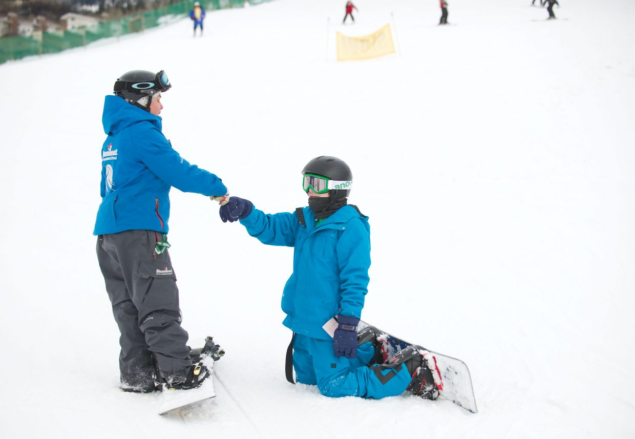 Kellen McDonald bumps fists with instructor Becca Carrera on Thursday afternoon at Steamboat Ski Area. McDonald was in Steamboat Springs as part of the Children's Hospital Burn Camp Program. This week's camp brought teens from across the country to Steamboat Springs to share their experience and have fun on the slopes.