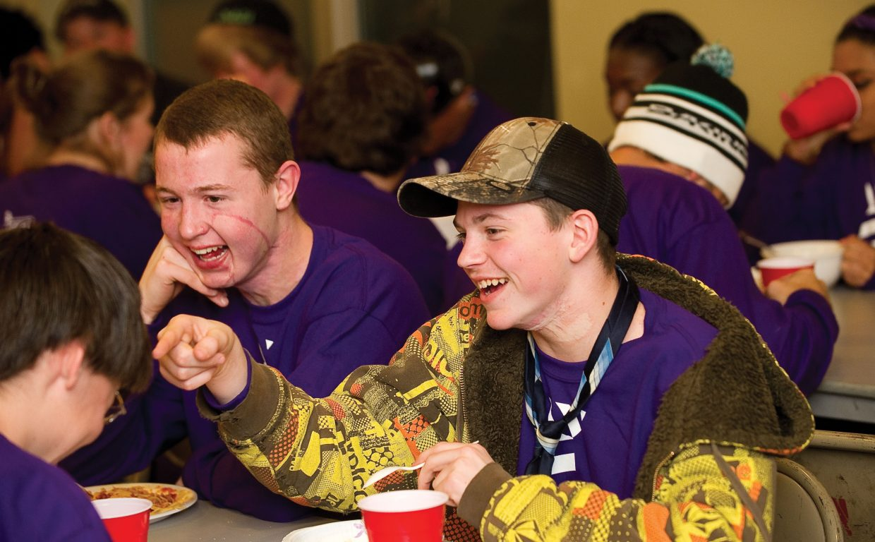 Tyler Ross, front, and Jonathan Burkhert enjoy a laugh during a dinner hosted by members of Steamboat Springs Fire Rescue on Wednesday evening at the Mountain Station. The teens were in Steamboat Springs as part of the Children's Hospital Burn Camp Program. This week's camp brought teens from across the country to Steamboat Springs to share their experience and have fun on the slopes.