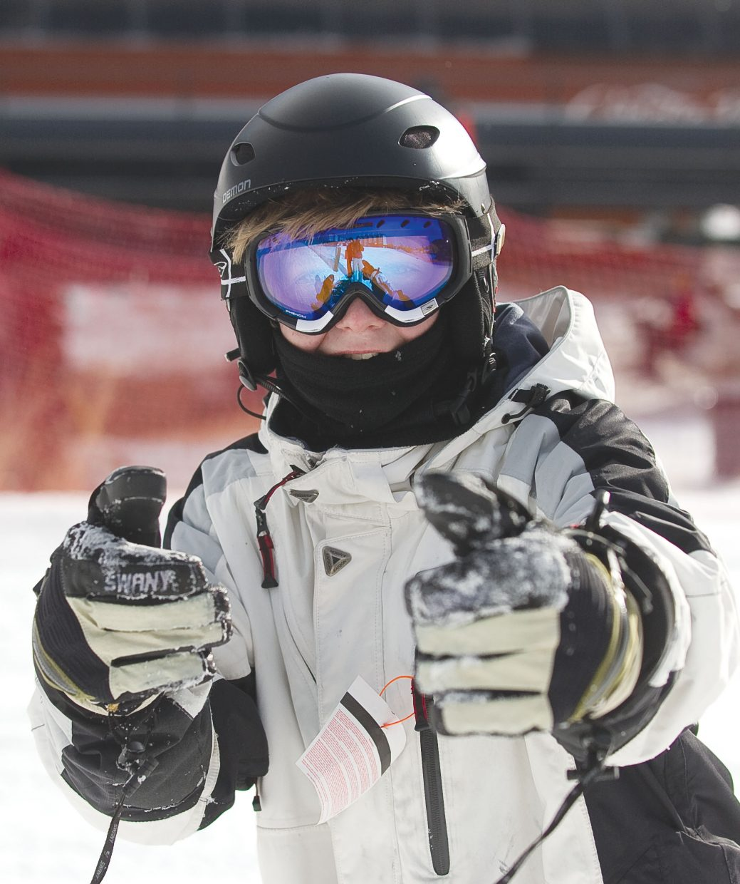 New snowboarder Ryan Zinkgraf gives two thumbs up after making his way down a run at the base of Steamboat Ski Area on Thursday afternoon. Ryan was in Steamboat Springs as part of the Children's Hospital Burn Camp Program. This week's camp brought teens from across the country to Steamboat Springs to share their experience and have fun on the slopes.