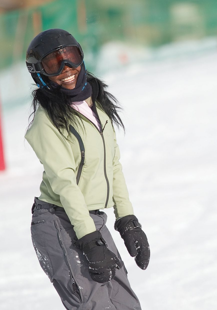 New snowboarder Jasmine Crutch smiles after making her way down a run at the base of Steamboat Ski Area on Thursday afternoon. Jasmine was in Steamboat Springs as part of the Children's Hospital Burn Camp Program. This week's camp brought teens from across the country to Steamboat Springs to share their experience and have fun on the slopes.