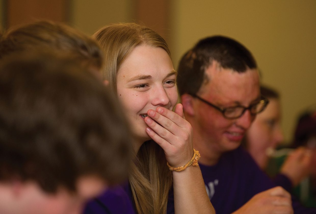 Carley Boos laughs with friends during a dinner hosted by members of Steamboat Springs Fire Rescue on Wednesday evening at the Mountain Station. Boos was in Steamboat Springs as part of the Children's Hospital Burn Camp Program. This week's camp brought teens from across the country to Steamboat Springs to share their experience and have fun on the slopes.