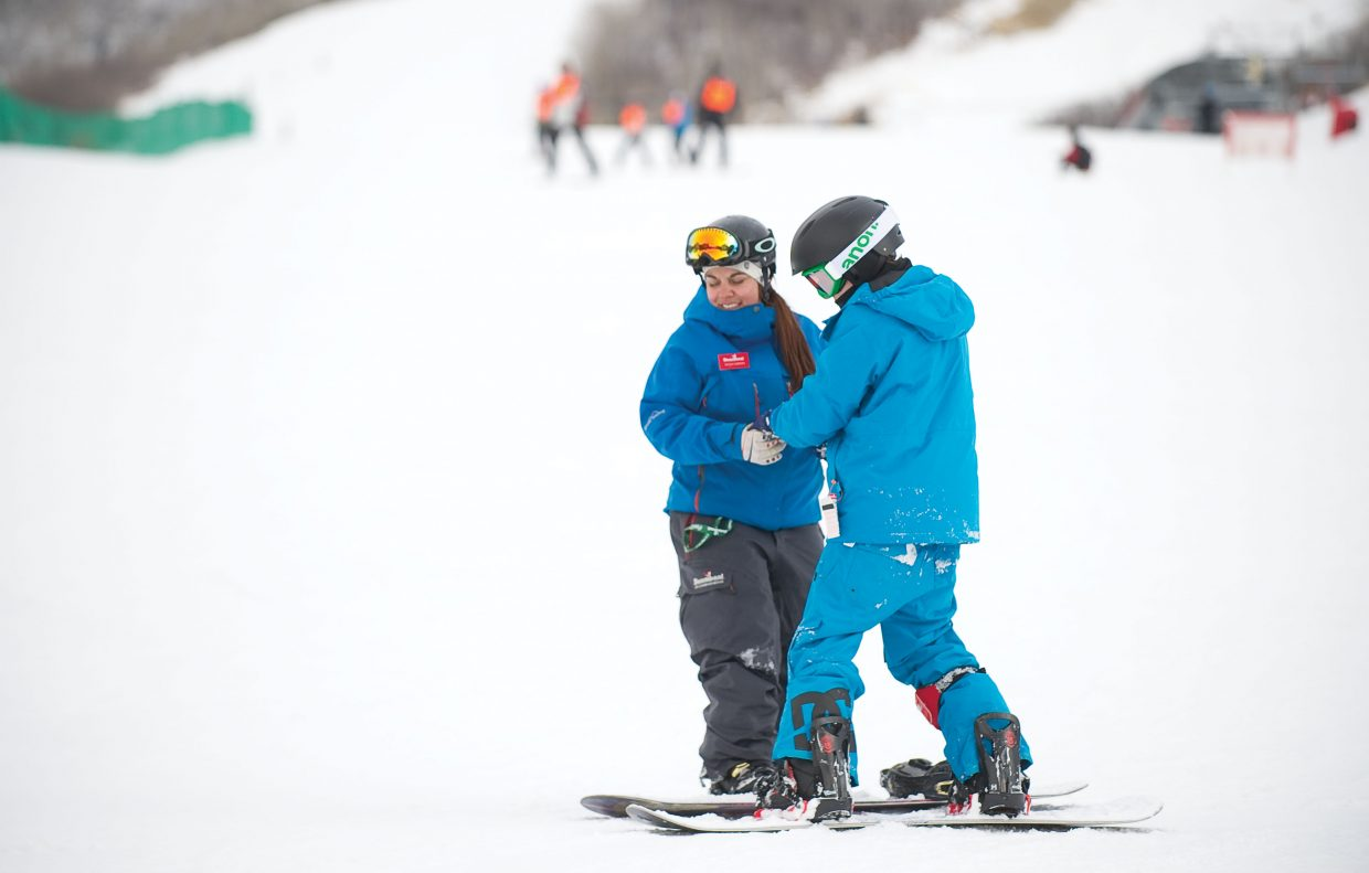 Kellen McDonald gets a hand from instructor Becca Carrera at Steamboat Ski Area on Thursday afternoon. McDonald was in Steamboat Springs as part of the Children's Hospital Burn Camp Program. This week's camp brought teens from across the country to Steamboat Springs to share their experience and have fun on the slopes.