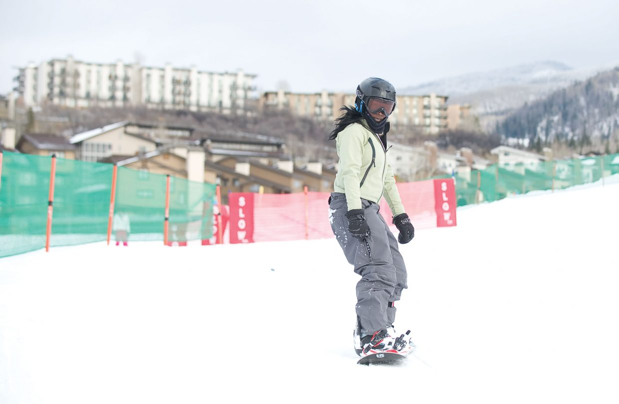 New snowboarder Jasmine Crutch looks at ease as she makes her way down a run at the base of Steamboat Ski Area on Thursday afternoon. Jasmine was in Steamboat Springs as part of the Children's Hospital Burn Camp Program. This week's camp brought teens from across the country to Steamboat Springs to share their experience and have fun on the slopes.