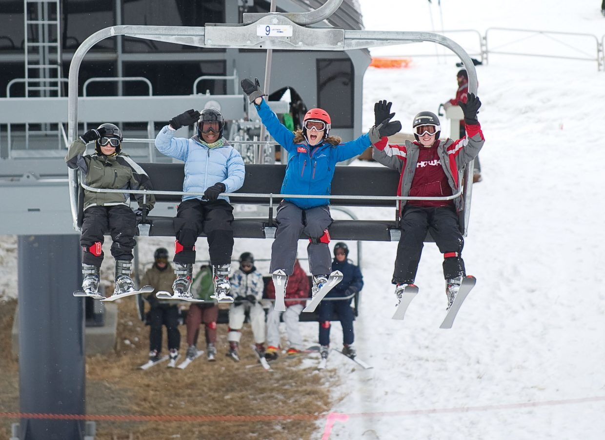 Skiers, from left, Brandon Caleb, Shakey Jones, Allison Tate (their instructor) and Justin Hofacker ride up the lift at the base of Steamboat Ski Area on Thursday afternoon. The group was in Steamboat Springs as part of the Children's Hospital Burn Camp Program. This week's camp brought teens from across the country to Steamboat Springs to share their experience and have fun on the slopes.
