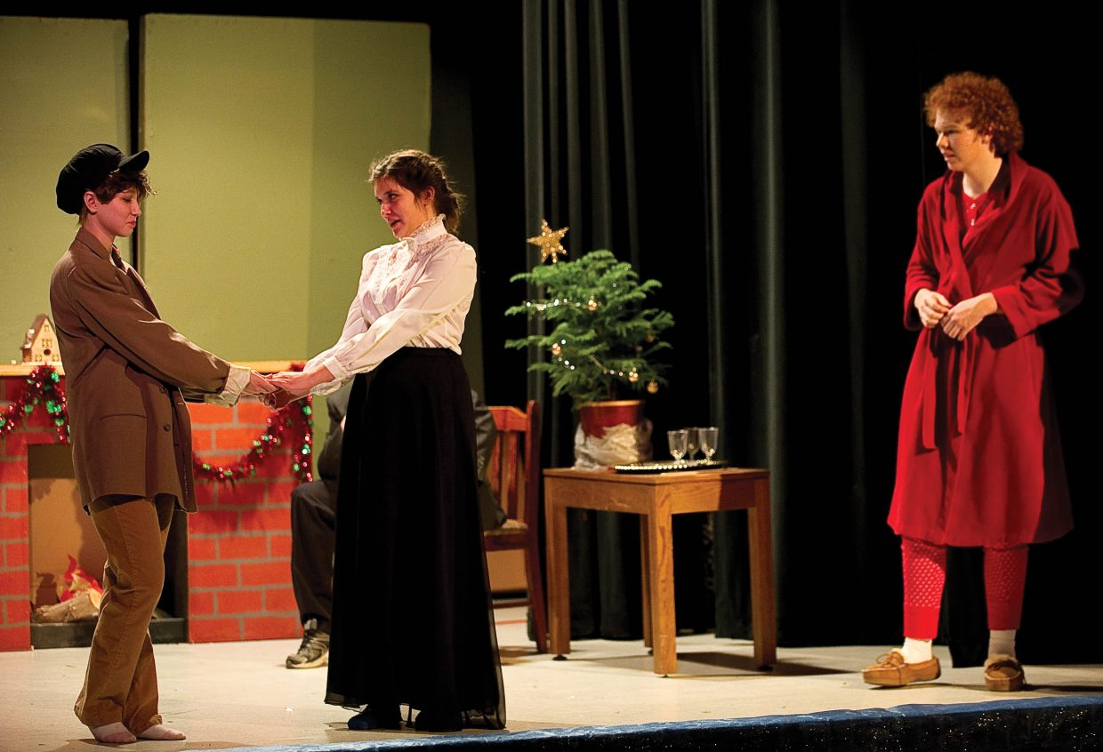 "Ebenezer Scrooge, played by Jake Rosendale, watches as a younger Scrooge, played by Zoie Lowe, share a dance with Miss Belle, played by Tyanna Zabel, in the Hayden Secondary Schools' presentation of ""A Christmas Carol."""