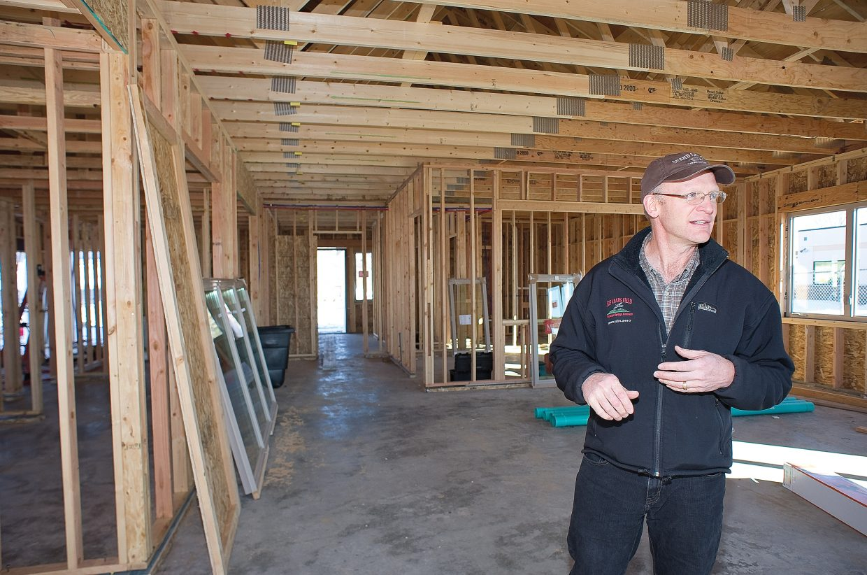 Steamboat Public Works Director Philo Shelton leads a tour of the new FBO building at the Steamboat Springs Airport on Thursday afternoon. Construction on the building, which will be used by private pilots flying in and out of Steamboat Springs, is ahead of schedule.