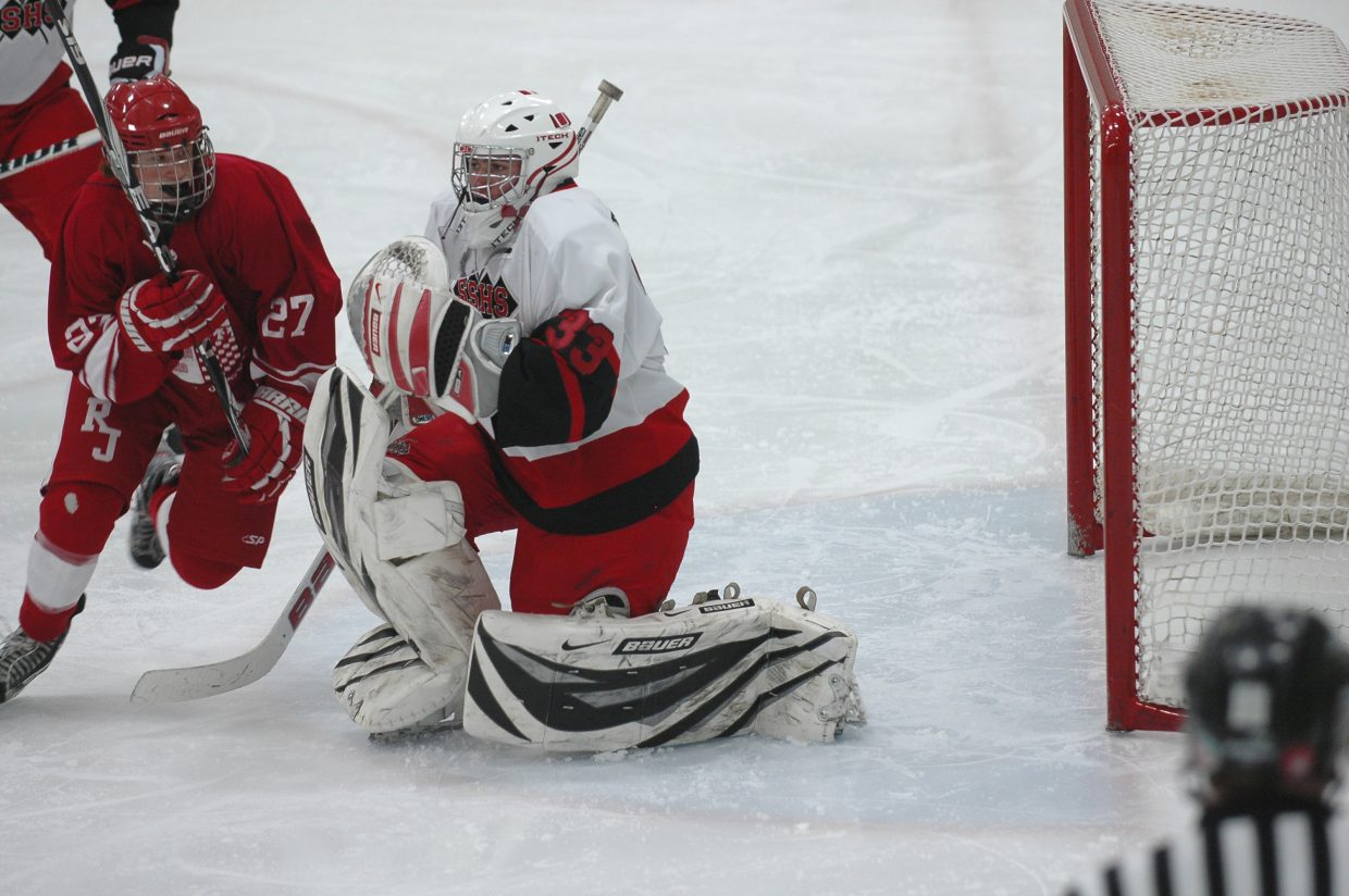 Steamboat Springs High School goaltender Thomas Tarcha makes a save in the second period of Saturday's 5-1 loss to Regis Jesuit.