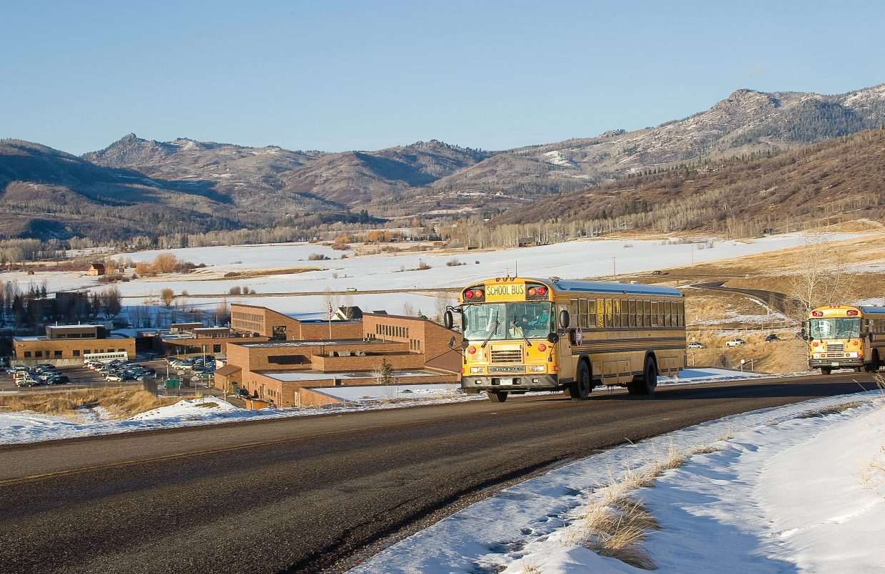 School buses leave the Strawberry Park Elementary School and Steamboat Springs Middle School campuses.