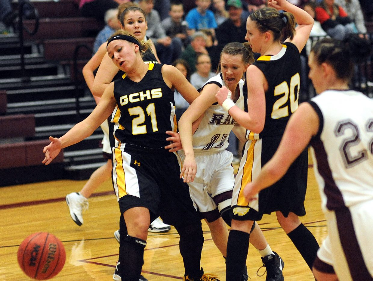 Soroco sophomore Marley Hammer tries to fight through a pair of defenders to get at a loose ball Saturday. The Rams hung in the game but lost by three.
