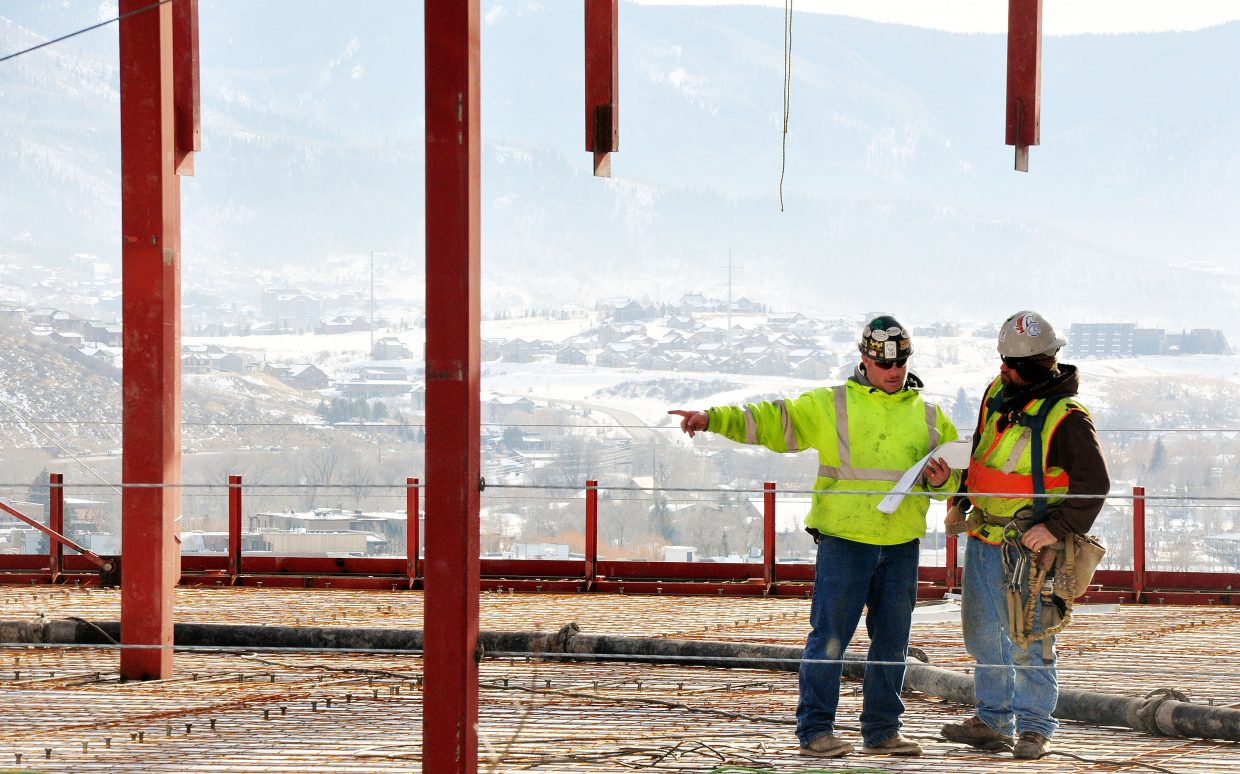 Pinnacle Constructors field superintendent Grady Wright, left, and Brent Felczak work Monday on what will become the top floor of the Colorado Mountain College's Alpine Campus' new academic facility.