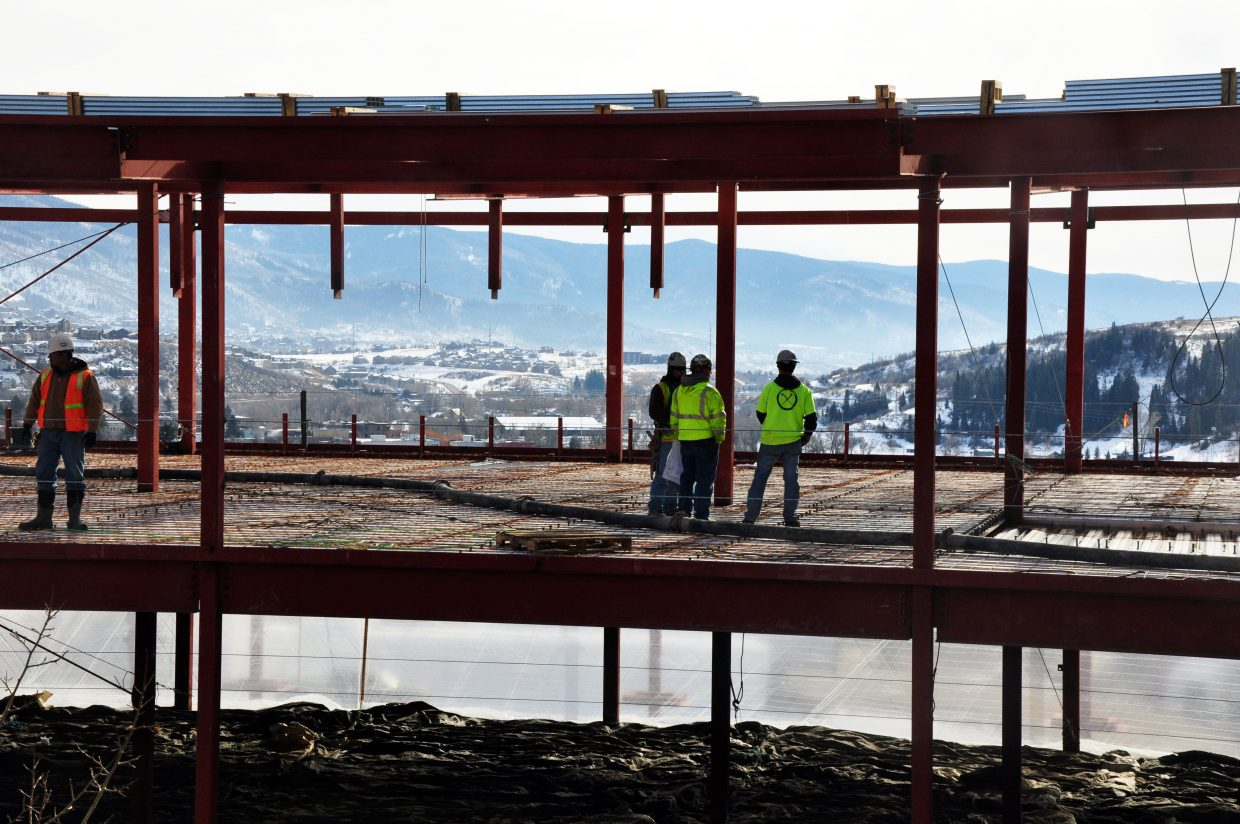 Crews work on the top story of Colorado Mountain College's Alpine Campus' new academic facility Monday. Workers are placing steel on the frame of the building.