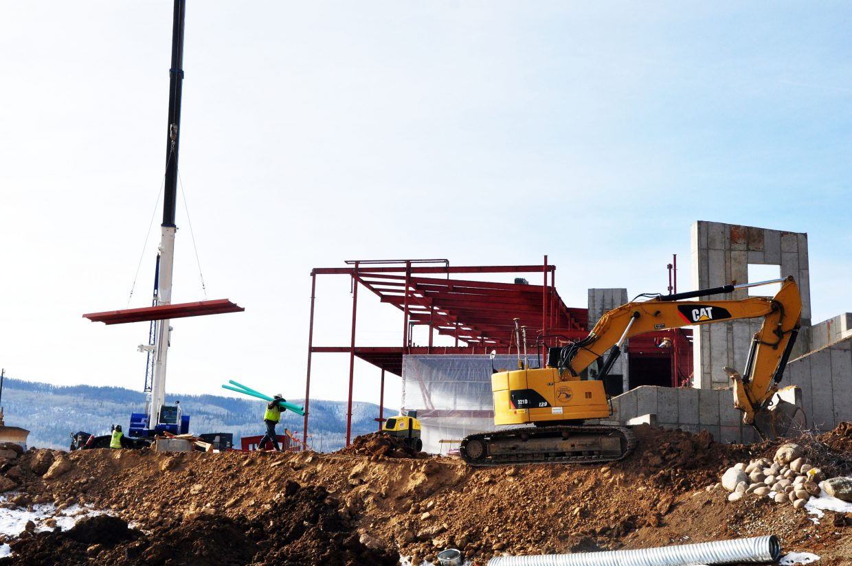 Construction crews work on the Alpine Campus' new academic facility Monday.