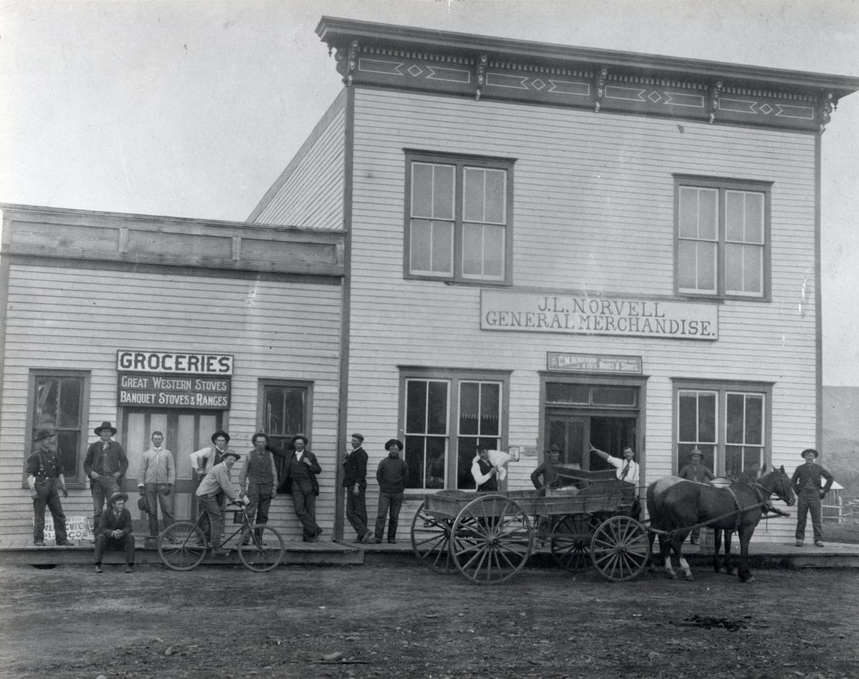 The building the HiWay Bar now resides in hosted the J.L. Norvell Mercantile Company, pictured above in this undated photograph, until 1915.