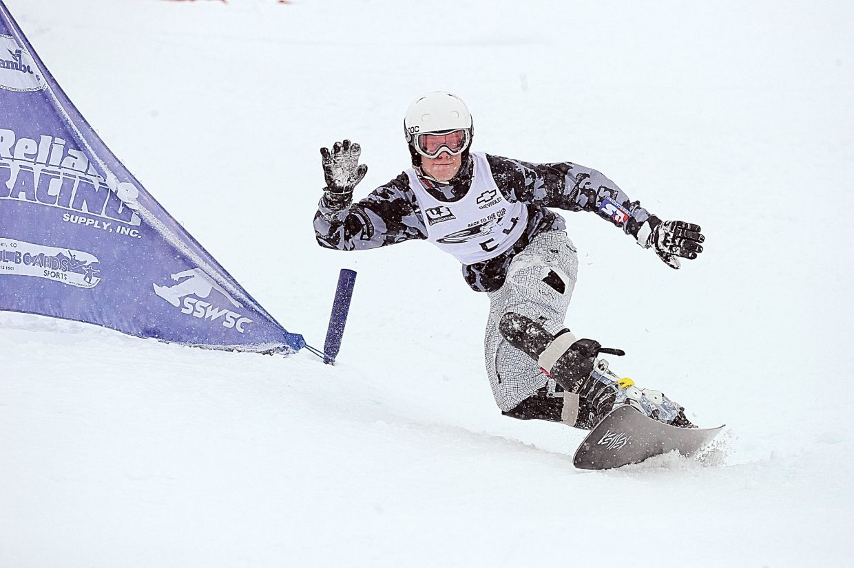 Steamboat Springs snowboarder Michael Trapp races down the face of Howelsen Hill on Tuesday during the Race to the Cup parallel slalom race.