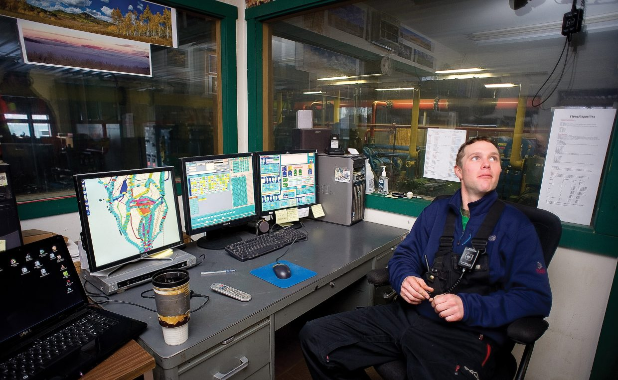 Supervisor Jesse Teague uses a number of computer monitors and information from snowmaking technicians to keep track of snowmaking operations at Steamboat Ski Area.