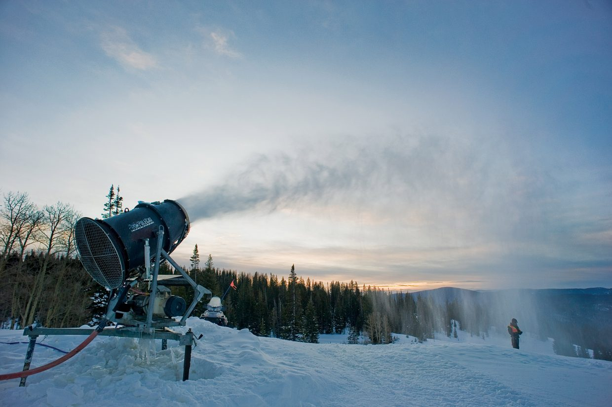 Snowmaking technician Pierce Delhaute takes a moment to check how one of the snow guns near the top of the Tomahawk ski run is functioning during an early-morning run at Steamboat Ski Area. Steamboat Ski and Resort Corp. hopes to complete snowmaking operations for the season sometime this month.