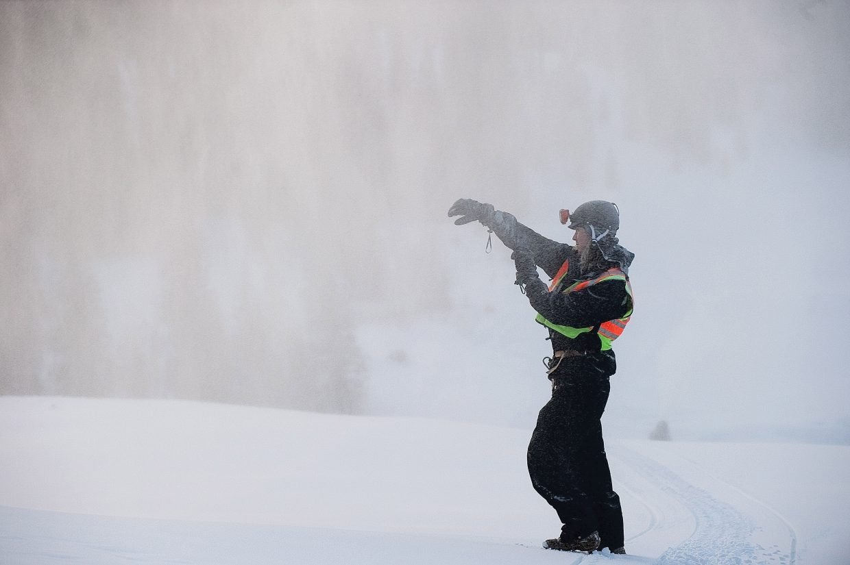 Snowmaking technician Pierce Delhaute checks the quality of snow coming from guns near the top of Steamboat Ski Area during an early morning run.