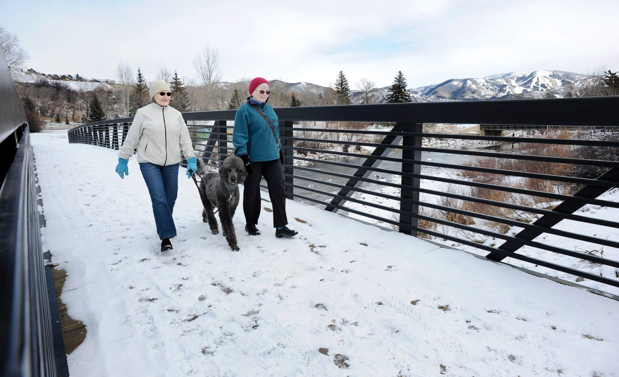 Pauline Bouchard, right, and Barbara Swissler walk across the new pedestrian bridge that connects the Yampa River Core Trail between West Lincoln Park and the Depot Art Center. The City of Steamboat Springs officially opened the bridge Thursday with a ribbon cutting ceremony. The $780,000 bridge was paid for mostly by grants, including nearly $700,000 from the Great Outdoors Colorado Trust Fund and Federal Highway Administration Enhancement grant funding. The Colorado Department of Transportation and the city split the $80,000 in design costs.