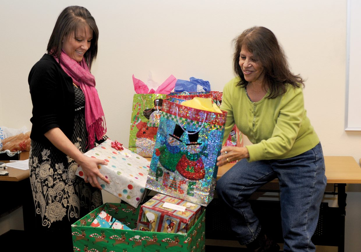 Volunteers with Routt County United Way's Holiday Wishes campaign prepare several of the gifts that will go to some of the 1,089 residents served by the program.