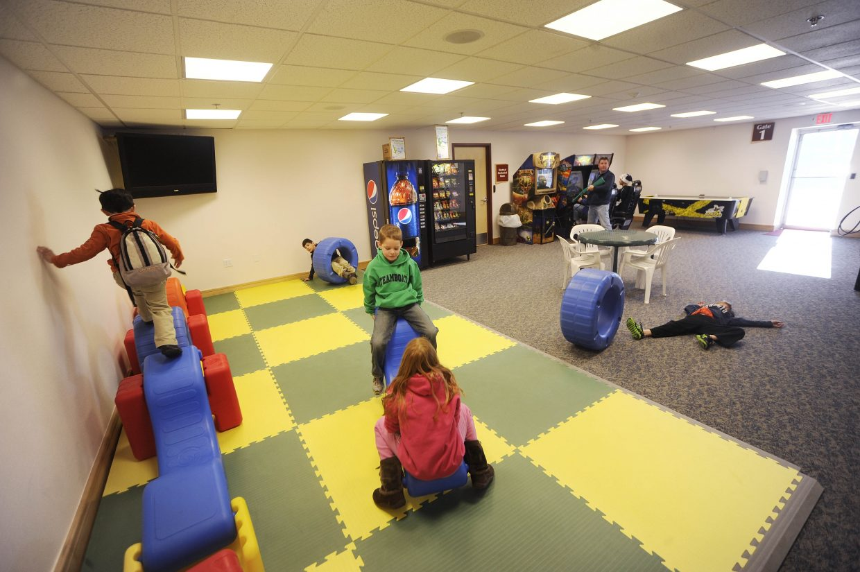 Kids play in the new game room at Yampa Valley Regional Airport.