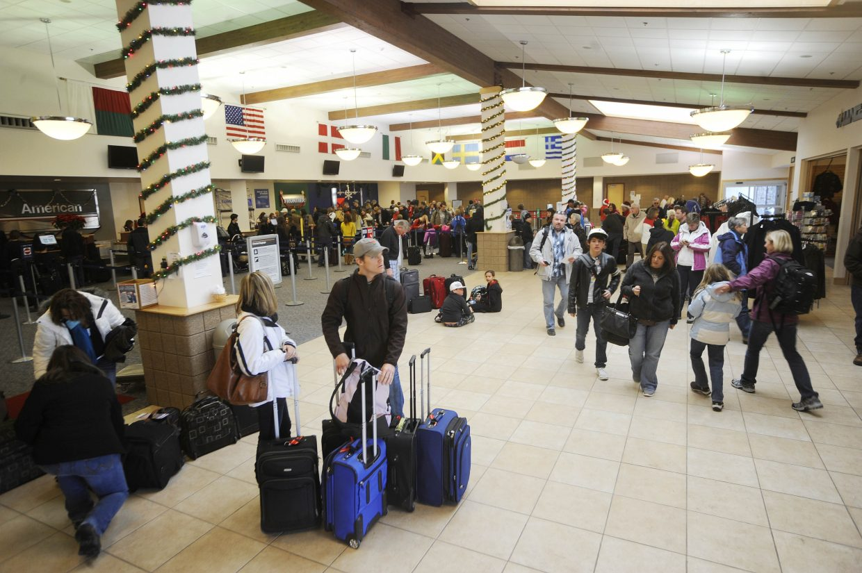 Passengers check in Friday at Yampa Valley Regional Airport.