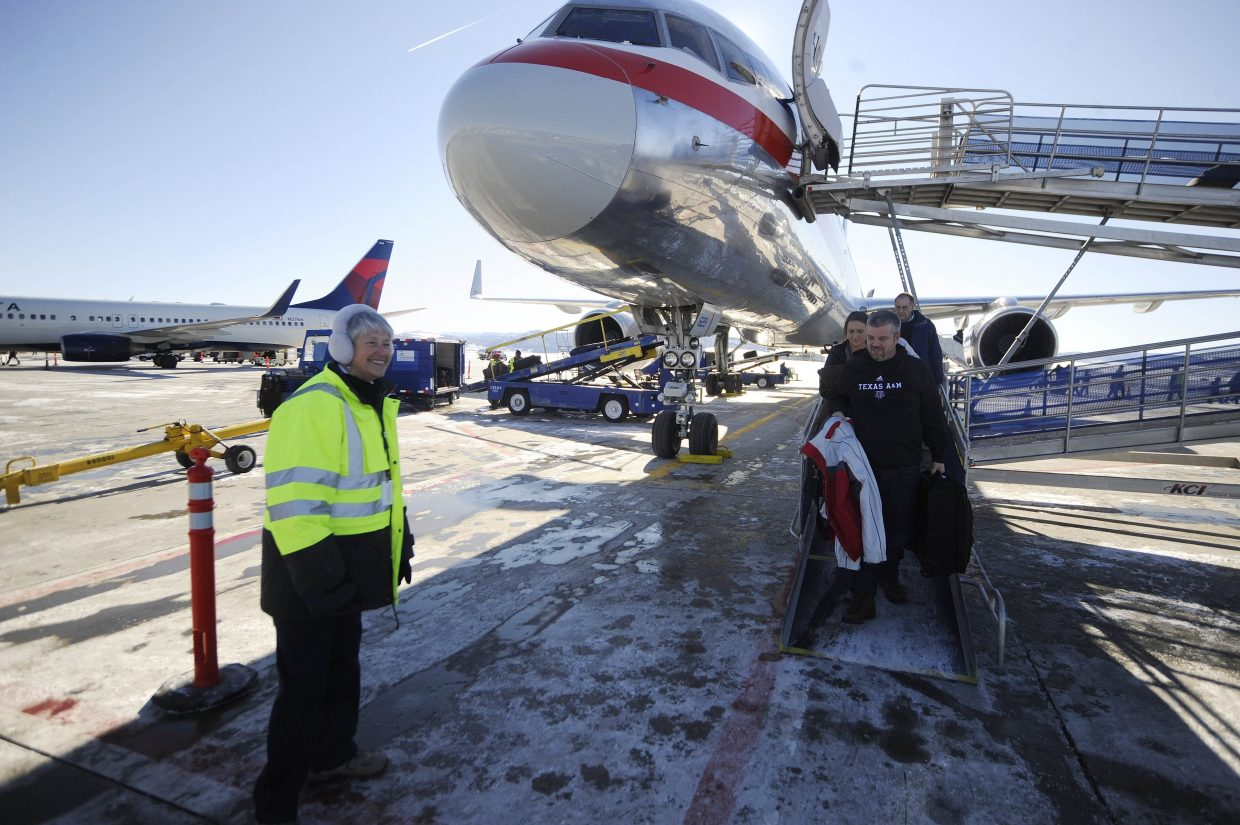 A Yampa Valley Regional Airport employee greets incoming passengers in 2017. The airport recently hired a new ground operator, United Ground Express, to replace SkyWest, which is scheduled to leave the airport in December.