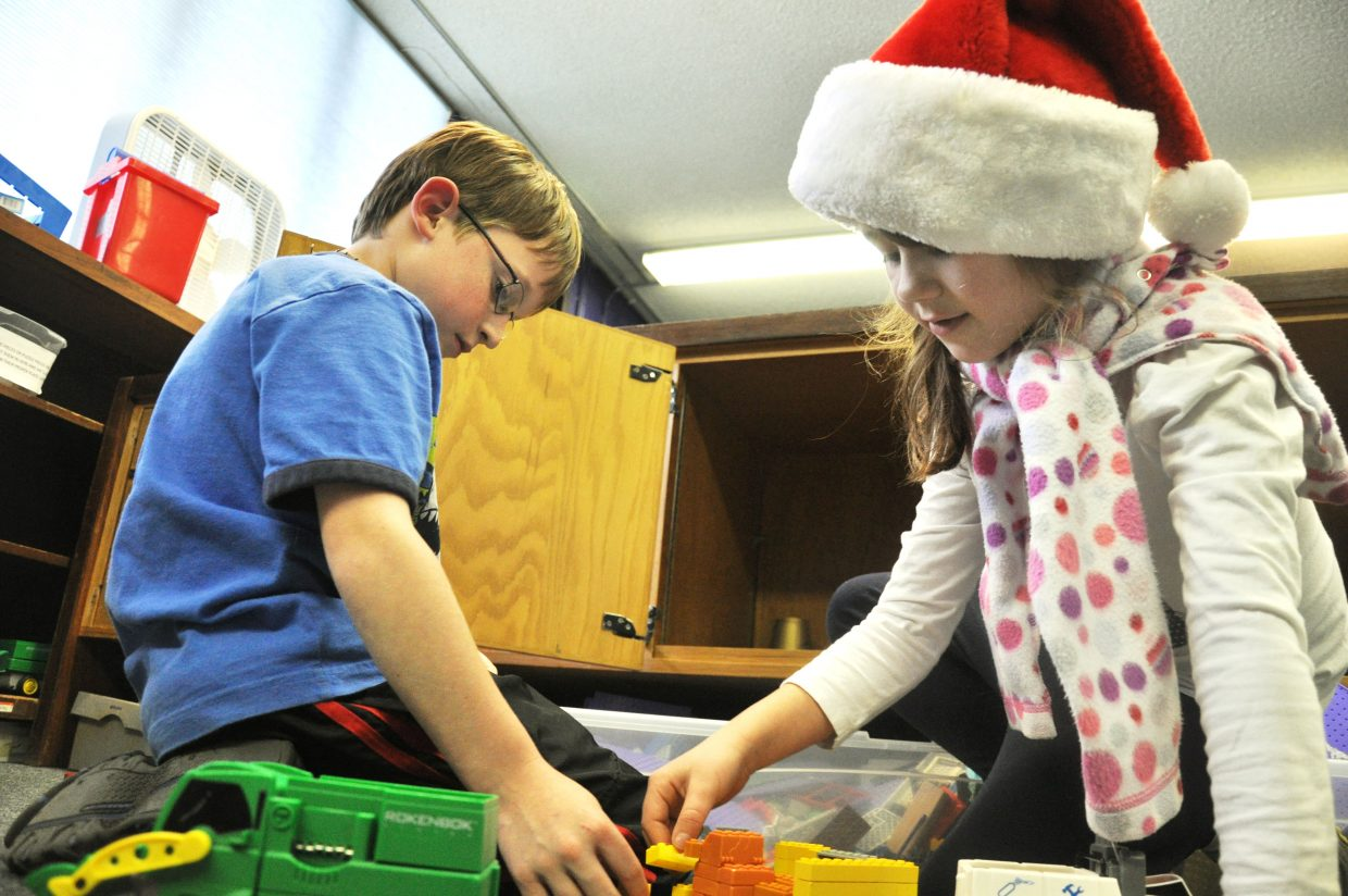 Mallory Thomas, right, and Wade Fortson play with toys Wednesday at the Boys & Girls Club of Steamboat Springs.