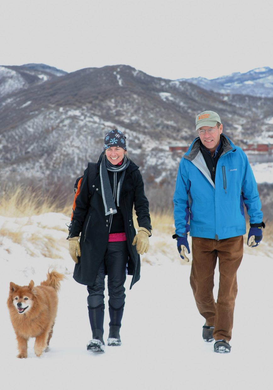 Jim Linville and his wife, Joan Donham, hike up the back side of Emerald Mountain on Thursday. Linville returned home from the Craig Hospital in Denver earlier this month after suffering a traumatic brain injury in a fall Oct. 27.