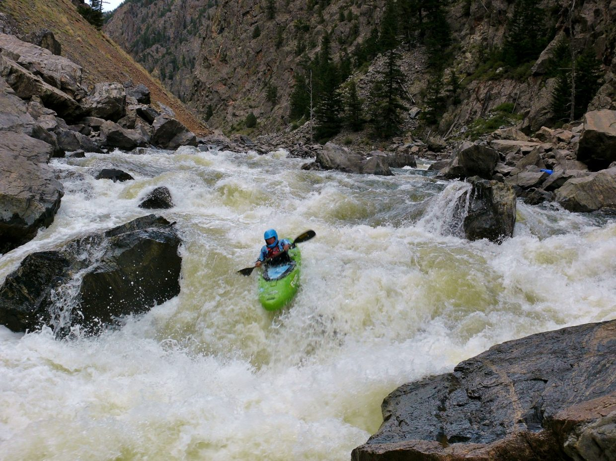 Sarah Piano at Tunnel Falls. The group of eleven paddled the four miles of flatwater from Kremmling to enter the Gore Canyon for five miles of whitewater. Submitted by: Matt Helm
