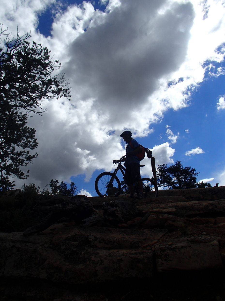 Steamboat Springs mountain biker Pete Owen stops for a break along the trail connecting Durango to Moab, Utah.